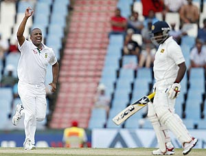 South Africa's Vernon Philander (left) celebrates the dismissal of Sri Lanka's Rangana Herath on Saturday