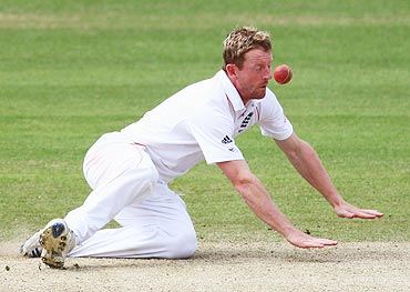 Paul Collingwood of England is hit by the ball
