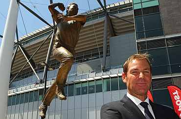 Shane Warne poses during the unveiling of the Shane Warne statue at the Melbourne Cricket Ground