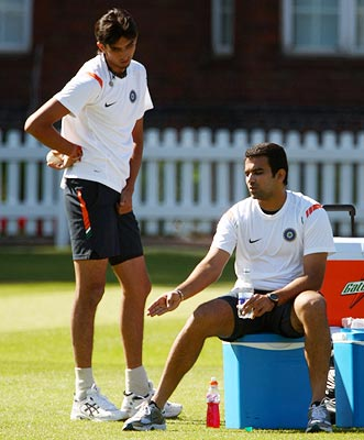 Zaheer Khan (right) speaks