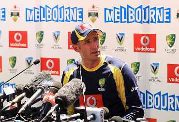 Mike Hussey speaks during a press conference