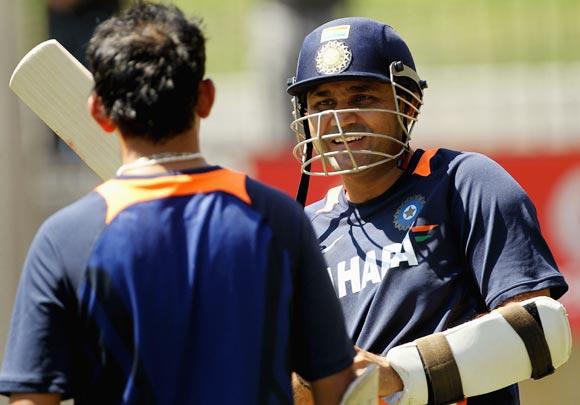 Virender Sehwag (right) chats to team-mate Gautam Gambhir