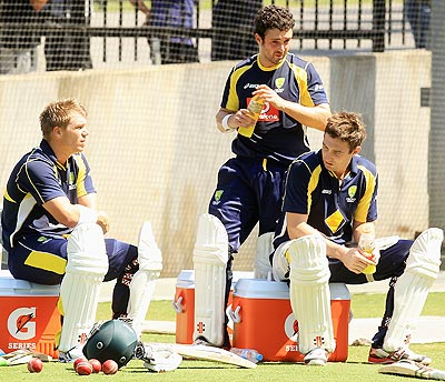 From left: David Warner, Ed Cowan and Shaun Marsh look on during an Australian Test team training session at Melbourne Cricket Ground