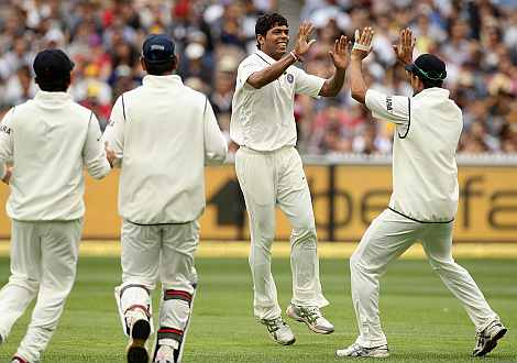 Umesh Yadav celebrates with team-mates