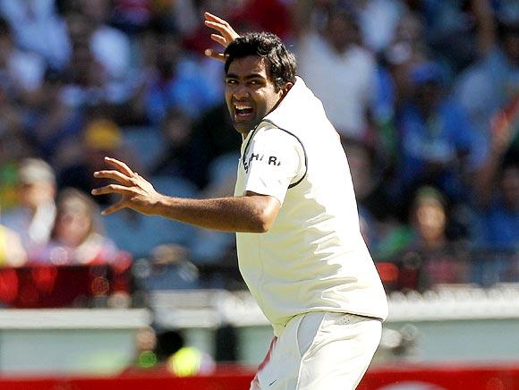 Ravichandran Ashwin celebrates after taking the wicket of Ed Cowan