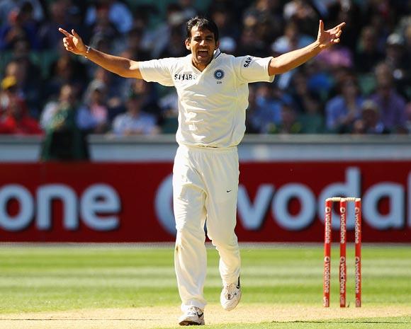 Zaheer Khan celebrates after taking the wicket Michael Clarke