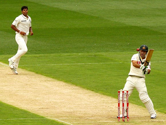 Ricky Ponting is struck on the helmet attempting a hook shot off the bowling of Umesh Yadav