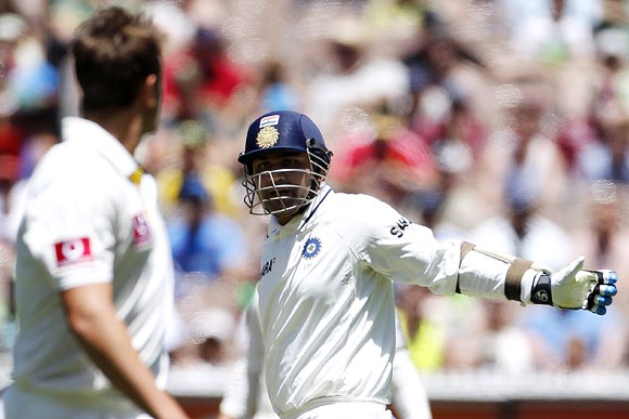 Virender Sehwag watches as James Pattinson appeals