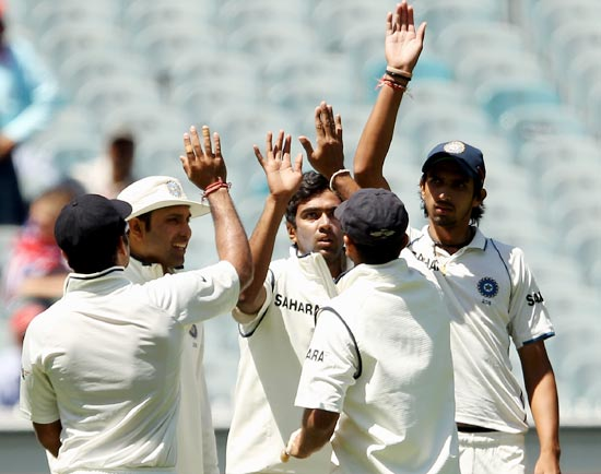 R Ashwin celebrates with his team-mates after taking the wicket of Ben Hilfenhaus