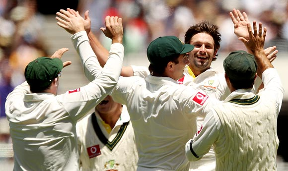 Ben Hilfenhaus of Australia is congratulated by team-mates after getting the wicket of Gautam Gambhir