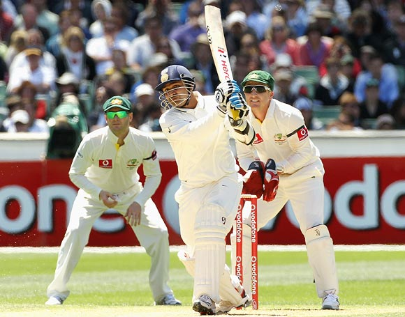 Virender Sehwag hits out as Michael Clarke (left) and Brad Haddin look on
