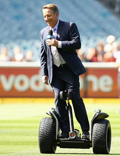 Ian Healy rides the Segway scooter
