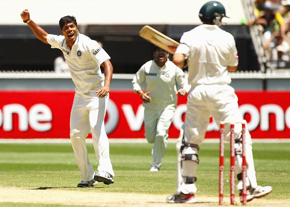 Umesh Yadav is jubilant after taking the wicket of Ed Cowan