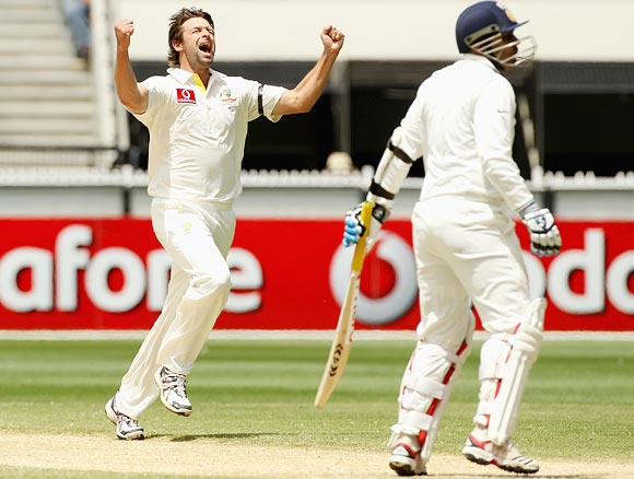 Ben Hilfenhaus celebrates after taking the wicket of Virender Sehwag