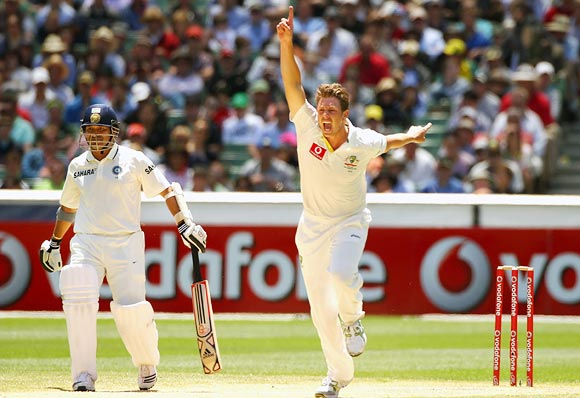 James Pattinson celebrates the wicket of Rahul Dravid as Sachin Tendulkar looks on