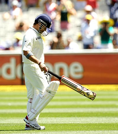 Sachin Tendulkar walks back after his dismissal