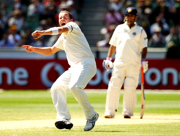 Peter Siddle is jubilant after getting the wicket of R Ashwin as Mahendra Singh Dhoni looks on