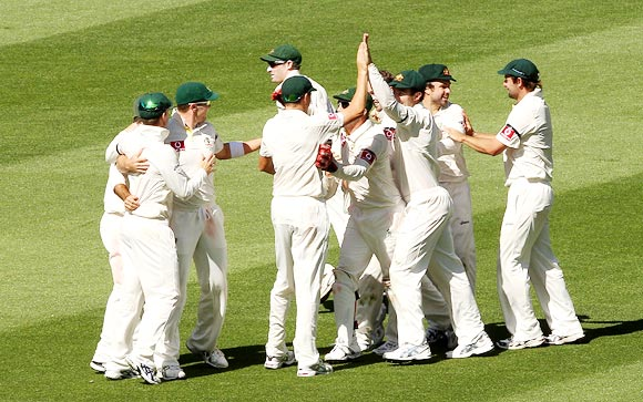 The Australian team celebrate winning the first Test in Melbourne