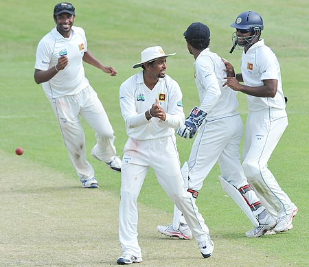 Tillakaratne Dilshan of Sri Lanka celebrates woth team-mates