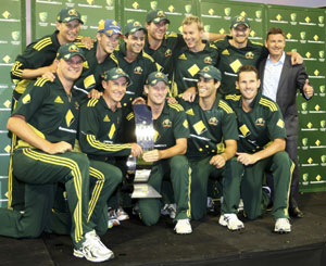 The Australian One-Day team pose with the trophy after their win over England in Perth on Sunday