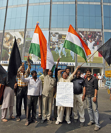 Demonstrators shout anti-ICC (International Cricket Council) slogans during a protest outside Eden Gardensin Kolkata on Monday