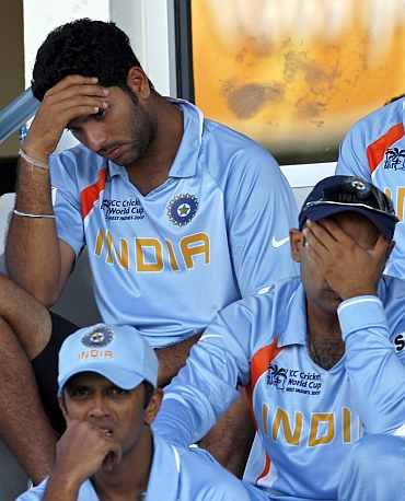 Indian players react after losing a match at World Cup 2007