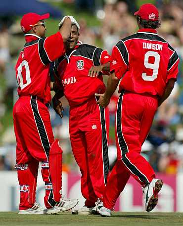 Canadian players celebrate after picking up a wicket