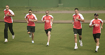 England's Stuart Broad, (left to right) Tim Bresnan, Paul Collingwood and Kevin Pietersen take part in a cricket training session on Monday
