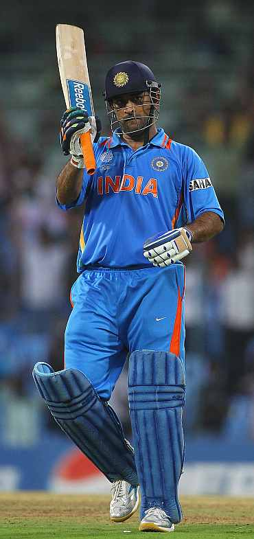 Mahendra Singh Dhoni celebrates scoring his century