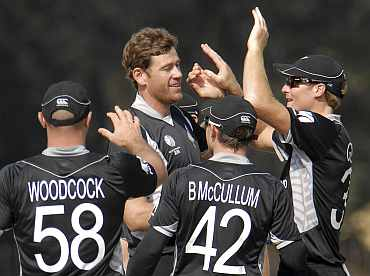 New Zealand players celebrate after dismissing an Indian player