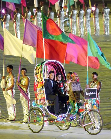 Bangladesh's captain Shakib Al Hasan arrives on a rickshaw at opening ceremony