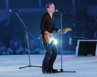 Bryan Adams performs at the opening ceremony