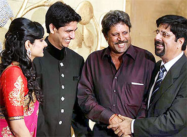 Kapil Dev attends Srikkanth's son's wedding reception.