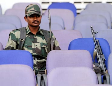 Security personnel watch the 2011 World Cup warm-up match between Zimbabwe and Ireland in Nagpur