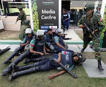 Security personnel take part in an emergency drill after a simulated blast at a stadium in Dhaka