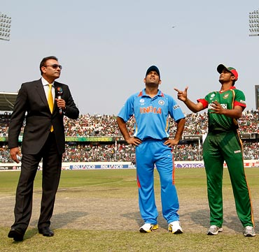 Commentator Ravi Shastri with India captain Mahendra Singh Dhoni and Bangladesh skipper Shakib Al