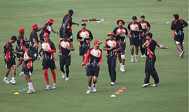 The Canadian squad warm up during the nets session on Saturday