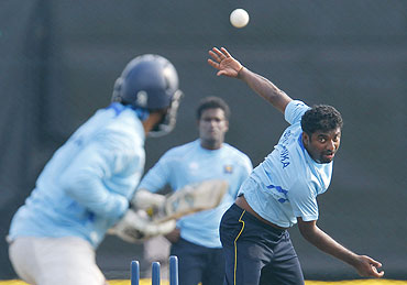 Sri Lanka's Muttiah Muralitharan bowls to Tillakaratne Dilshan during a practice session in Hambantota district on Friday