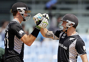 New Zealand's Brendon McCullum (right) and Martin Guptill celebrate their victory over Kenya in Chennai on Sunday