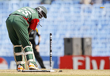 Kenya's Steve Tikolo looks back as he is bowled by New Zealand's Hamish Bennett in Chennai on Sunday