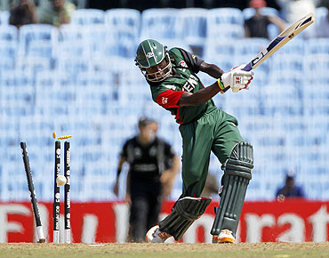 Kenya's Nehemiah Odhiambo is bowled by New Zealand's Tim Southee during their match in Chennai on Sunday