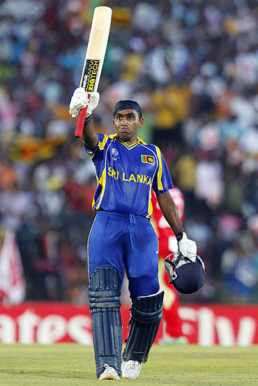 Mahela Jayawardene acknowledges the crowd after completing his century against Canada on Sunday