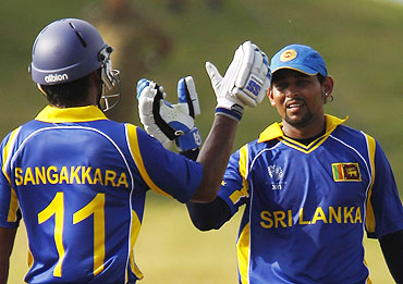 Sri Lanka's Tillakaratne Dilshan (right) celebrates with captain Kumar Sangakkara after scoring a half century against Canada on Sunday