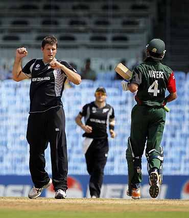 Hamish Bennett celebrates after claiming a Kenyan wicket