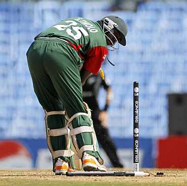 Kenya's Steve Tikolo is clean bowled by Bennett