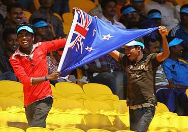 New Zealand fans wave the flag during the match against Kenya