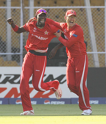Chris Mpofu (left) celebrates with teammate Charles Coventry after running out Ricky Ponting