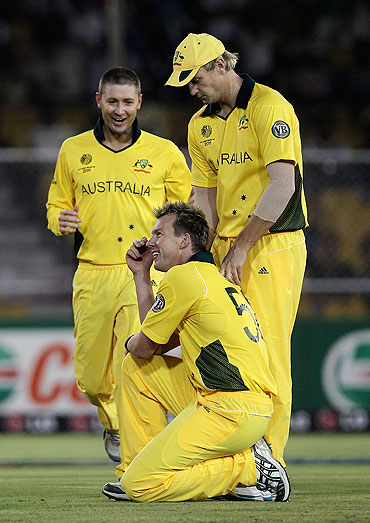 Brett Lee is congratulated by teammates after dismissing Charles Coventry