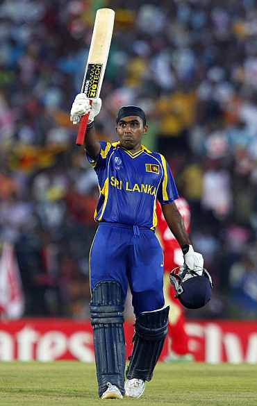 Mahela Jayawardene celebrates after reaching his century