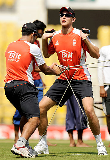 England's Stuart Broad (right) stretches with team-mate Ravi Bopara during a training session in Nagpur on Monday